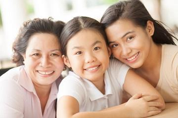 Grandmother, mother, and granddaughter smiling | Dentist Modbury SA